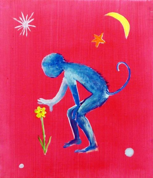 קוף מלטף פרח
